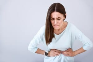 Woman with tummy pain